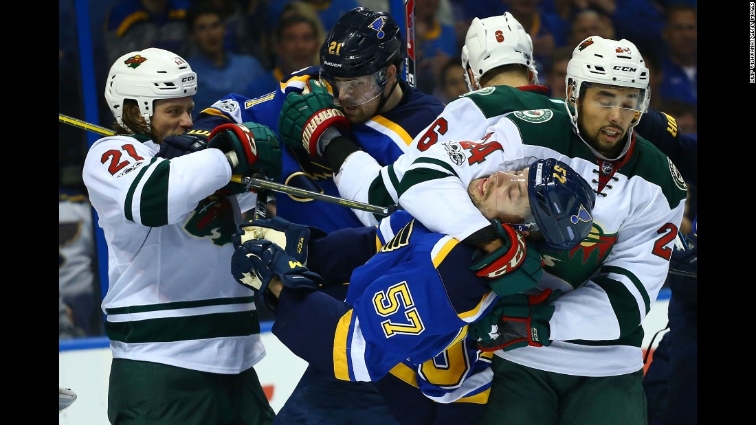 Minnesota's Matt Dumba puts St. Louis' David Perron in a headlock during an NHL playoff game on Wednesday, April 19.