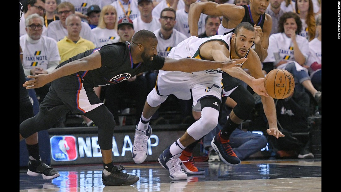 Los Angeles Clippers guard Raymond Felton, left, competes for a loose ball with Utah's Rudy Gobert during an NBA playoff game on Sunday, April 23.