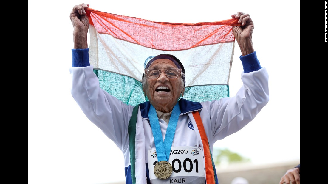 Man Kaur, a 101-year-old woman from India, celebrates after running a 100-meter dash at the World Masters Games on Monday, April 24. She was the only athlete in her age category (100+).