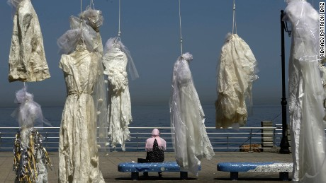 Wedding dresses hang from nooses in Beirut in a protest against a law that allows rapists in Lebanon to avoid punishment if they marry their victims. Nine Arab countries have similar loopholes.