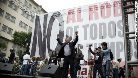 Mexican former presidential candidate and leader of the MORENA movement, Andres Manuel Lopez Obrador, raises his arms before delivering a speech against the energetic reform proposed by Mexican President Enrique Pena Nieto, during a rally along Juarez Avenue in Mexico City, on September 8, 2013.   AFP PHOTO/ Yuri CORTEZ        (Photo credit should read YURI CORTEZ/AFP/Getty Images)