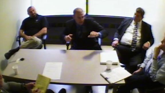 Cleveland Police officer Timothy Loehmann (center) explained to officials the events before, during, and after the shooting of Tamir Rice, 12, in 2014.