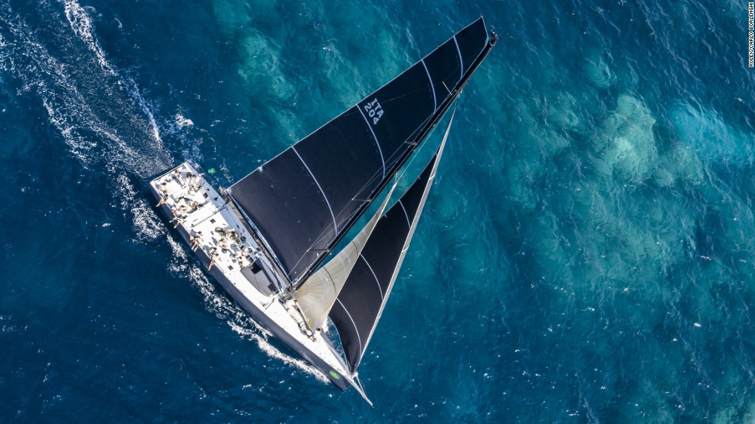 The Farr 70 Atalanta II skirts a shallow reef on a glamor day for sailing.