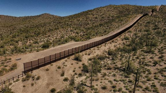 View of the metal fence along the border in Sonoyta, Sonora state, northern Mexico, between the Altar desert in Mexico and the Arizona desert in the United States, on March 27, 2017. Threatened species like the Sonoran pronghorn or desert bighorn sheep freely cross the border between Mexico and the United States in protected biospheres, but the construction of US President Donald Trump's wall will block their movement in these desert valleys and could drive them to extinction. / AFP PHOTO / PEDRO PARDO        (Photo credit should read PEDRO PARDO/AFP/Getty Images)
