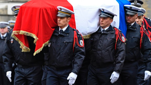 French police officers carry Jugelé's flag-draped casket.
