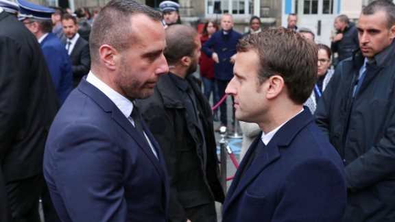 Cardiles (L) shakes hands with then-candidate Emmanuel Macron at a ceremony for Jugelé in April.