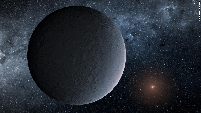"""This artist's concept shows OGLE-2016-BLG-1195Lb, a planet orbiting an incredibly faint star 13,000 light-years away from us. It is an """"iceball"""" planet with temperatures reaching minus-400 degrees Fahrenheit."""
