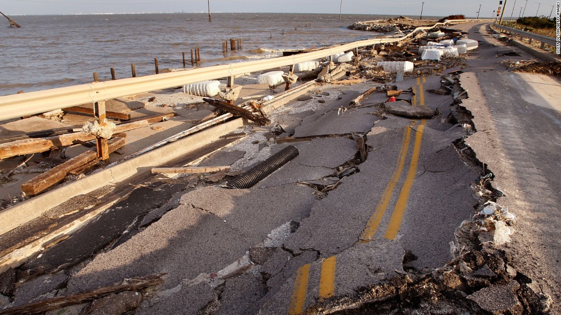 A collapsed road sits in disrepair on September 15, 2008, in Galveston, Texas, following Hurricane Ike.