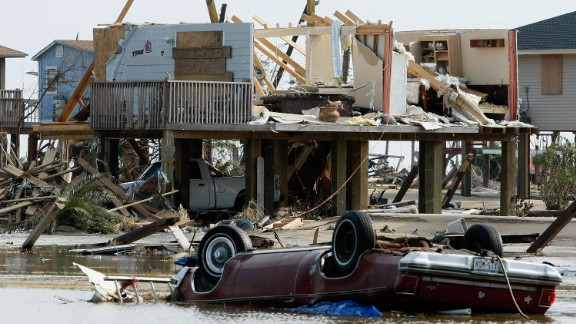 A home and a car lie destroyed by Hurricane Ike September 17, 2008 in Crystal Beach, Texas. Hurricane Ike caused widespread damage and power outages on the Texas coast.