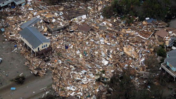 Houses sit amid debris on September 14, 2008, in Crystal Beach, Texas, after Hurricane Ike swept through the area.