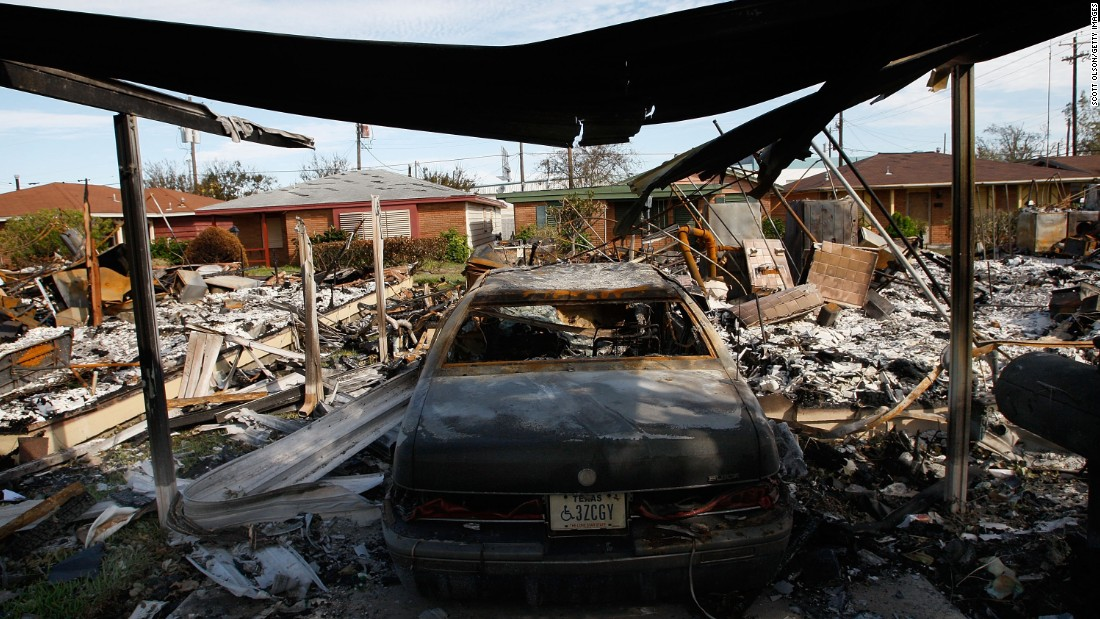 A car sits in a burned-out garage on September 16, 2008, in Galveston, Texas, the result of one of many fires sparked by Hurricane Ike.