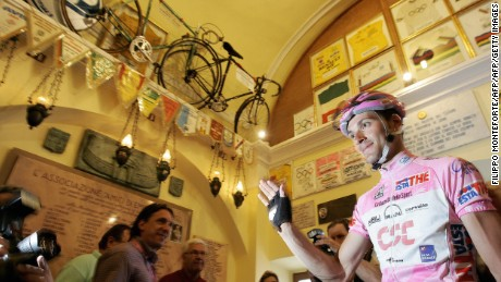 Italy's Ivan Basso, wearing the leader's pink jersey, visits the Ghisallo chapel during the 2006 Giro d'Italia.