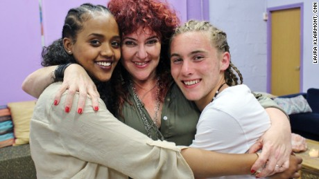 CNN Hero Mariuma Ben Yosef (center) runs Shanti House, a facility in Israel that assists homeless youth. She hugs two participants who have received the program's services.