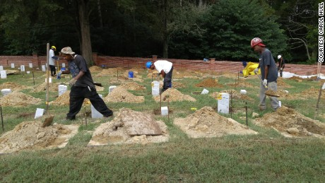 Workers put in new headstones last summer at Poplar Grove National Cemetery.