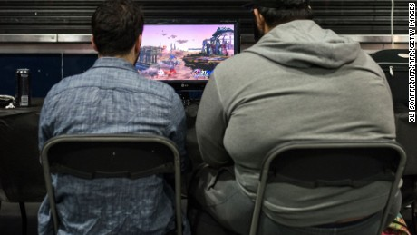 Competitors take part in the 'King of the North' gaming festival held at the Manchester Academy venue in Manchester, northern England on March 22, 2017. King of the North hosts the grand finals of the UK's largest student e-sports tournament as well as computer game and board game competitions. / AFP PHOTO / Oli SCARFF        (Photo credit should read OLI SCARFF/AFP/Getty Images)