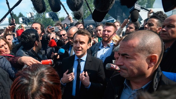 Macron was jeered when he first arrived at the factory.