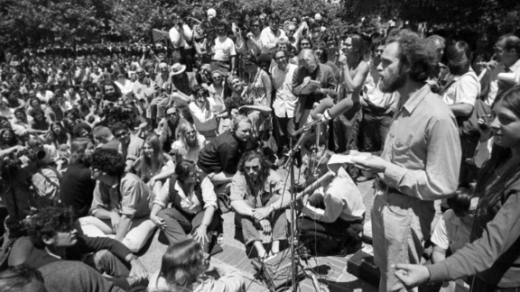 """Mario Savio, right, speaks at a """"Peoples Park"""" free-speech rally at UC Berkeley in June 1969."""