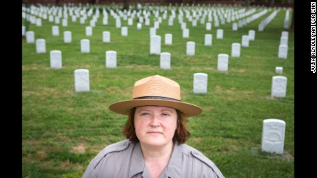 "Elizabeth Dinger is the lead park ranger at Poplar Grove National Cemetery in Dinwiddie County, Virginia. ""These men died fighting for their country ... putting this right is the last nice thing we can do for these soldiers,"" she said."