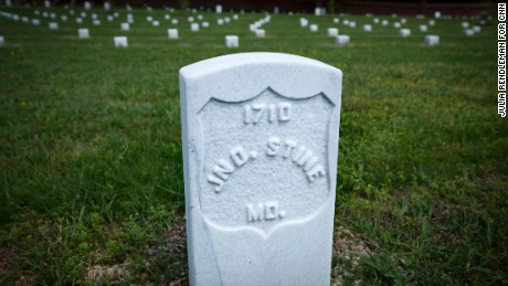 The faded grave marker of John Stine (below) once lay on the ground at Poplar Grove National Cemetery.