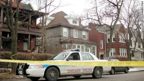 A Chicago Police car is parked in front of the home of United States District Judge Joan Lefkow, March 1, 2005, in Chicago, where her husband and mother, Michael Lefkow and Donna Humphrey, were found murdered.