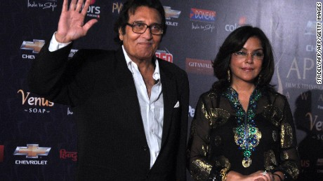 "Bollywood actors Vinod Khanna and Zeenat Aman pose as they arrive for the ""7th Apsara Awards"" ceremony in Mumbai on January 25, 2012."
