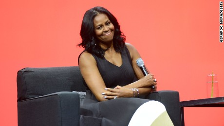 Former United States first lady Michelle Obama smiles during the AIA Conference on Architecture 2017 on April 27, 2017 in Orlando, Florida.