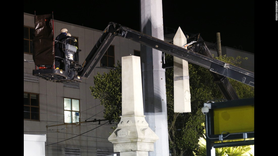 "Workers in New Orleans dismantle the Battle of Liberty Place monument on Monday, April 24. It was the first of <a href=""http://www.cnn.com/2017/04/24/us/new-orleans-confederate-statues/"" target=""_blank"">four scheduled relocations</a> of Confederate memorials in New Orleans. Mayor Mitch Landrieu's office said the statues will go to storage while the city looks for a suitable venue to display them."