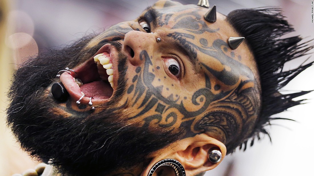 Emilio Gonzalez shows off his tattoos and piercings on Friday, April 21, the first day of the Frankfurt Tattoo Convention in Frankfurt, Germany.