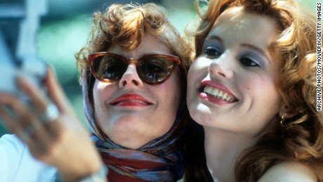 Susan Sarandon and Geena Davis taking Polaroid of themselves in a scene from the film 'Thelma & Louise', 1991. (Photo by Metro-Goldwyn-Mayer/Getty Images)