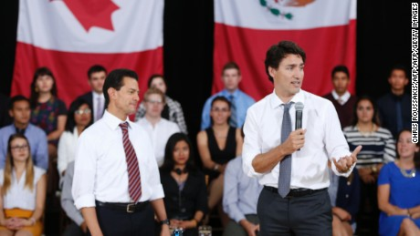 "Mexican President Enrique Pena Nieto (left) and Canadian Prime Minister Justin Trudeau (right) take part in a youth question and answer session ahead of the ""Three Amigos Summit"" in Ottawa, June 28, 2016.      Canadian Prime Minister Justin Trudeau and his guests US President Barack Obama and Mexican President Enrique Pena Nieto will meet in Ottawa for the North American Leaders Summit June 29 morning under a climate of economic uncertainty following Britain's vote to leave the European Union. / AFP / Chris Roussakis        (Photo credit should read CHRIS ROUSSAKIS/AFP/Getty Images)"