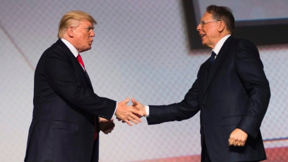 US President Donald Trump shakes hands with National Rifle Association (NRA) President Wayne LaPierre (R) during the NRA Leadership Forum in Atlanta, GA, April 28, 2017, with NRA-ILA Executive Director Chris Cox (L). / AFP PHOTO / JIM WATSON        (Photo credit should read JIM WATSON/AFP/Getty Images)