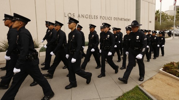 LAPD recruits march in processional as the Los Angeles Police Department holds a graduation ceremony led by LAPD Chief Charlie Beck and Mayor Eric Garcetti.