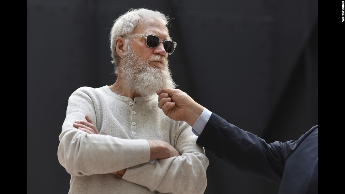 Former talk-show host David Letterman has his beard tugged by US Sen. Al Franken as they meet with climate-change activists in Washington on Friday, April 28.