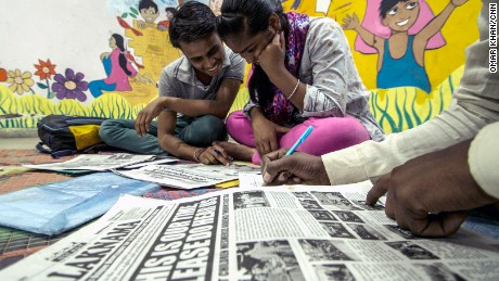 Reporters Deepak and Joti examine an early edition of Balaknama, a newspaper by street children in Delhi.