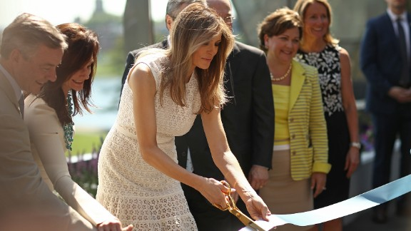 The first lady takes part in a ribbon-cutting ceremony at the Children