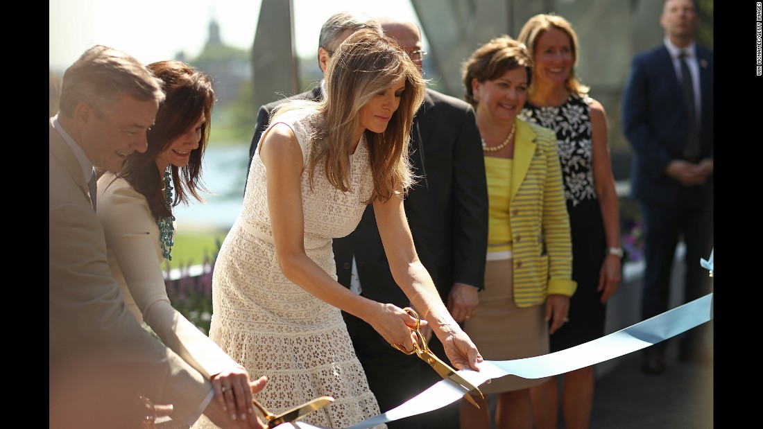 The first lady takes part in a ribbon-cutting ceremony at the Children's National Health System in Washington. She spoke at the opening of the Bunny Mellon Healing Garden, where patients and families can spend time outdoors while receiving treatment at the hospital.