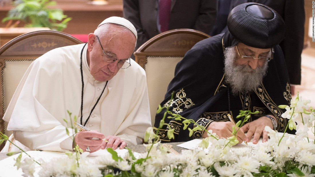 "Francis and Pope Tawadros II, head of Egypt's Coptic Orthodox Church, sign a joint declaration reiterating the fraternity between their churches at Cairo's St. Mark's Cathedral. ""Let us intensify our unceasing prayer for all Christians in Egypt and throughout the whole world, and especially in the Middle East,"" the declaration said on Friday, April 28."