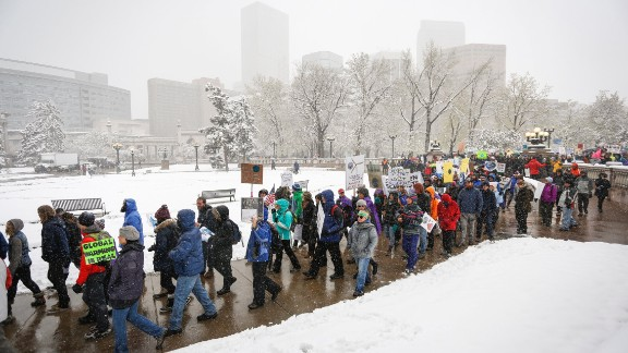 Protesters march in Denver.