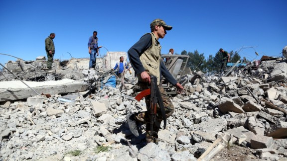 YPG fighters on Wednesday visit the site of Turkish airstrikes near the Syrian Kurdish town of Derik.