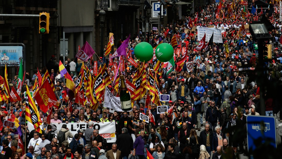 People march during a May Day rally in Barcelona, Spain.