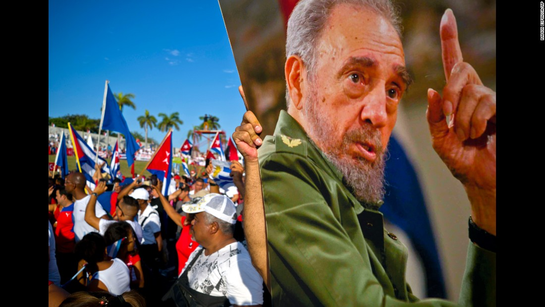 People in Havana, Cuba, carry a photo of late leader Fidel Castro during a May Day parade.