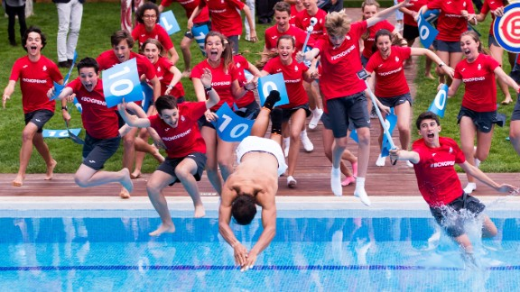 BARCELONA, SPAIN - APRIL 30:  Rafael Nadal of Spain dives in the swimming pool with ballboys after his victory against Dominic Thiem of Austria in their final match on day seven of the Barcelona Open Banc Sabadell on April 30, 2017 in Barcelona, Spain.  (Photo by Alex Caparros/Getty Images)