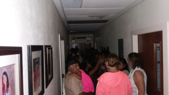 Parishioners shelter inside a hallway at St. John the Evangelist Catholic Church in Emory.