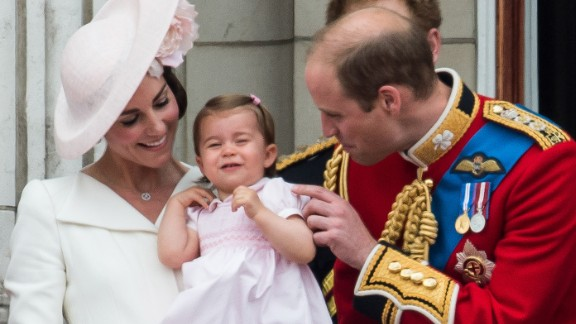 William and Catherine attend to Charlotte during celebrations marking the Queen