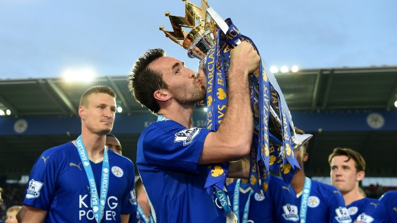 LEICESTER, ENGLAND - MAY 07:  Christian Fuchs of Leicester City kisses the Premier League Trophy as players and staffs celebrate the season champions after the Barclays Premier League match between Leicester City and Everton at The King Power Stadium on May 7, 2016 in Leicester, United Kingdom.  (Photo by Michael Regan/Getty Images)