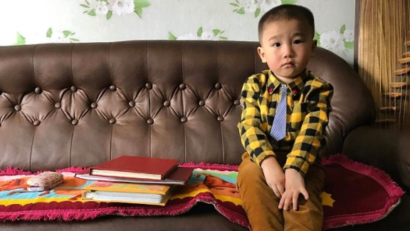 A North Korean boy sits in his family