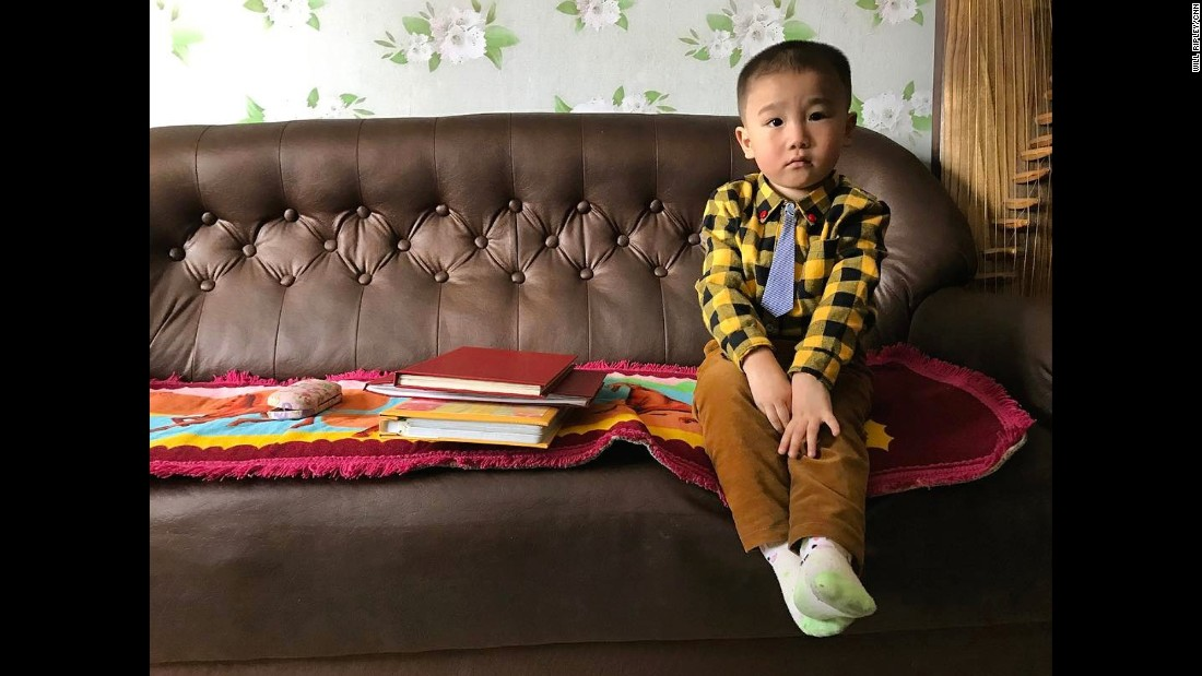 A North Korean boy sits in his family's living room on April 30 in Pyongyang.