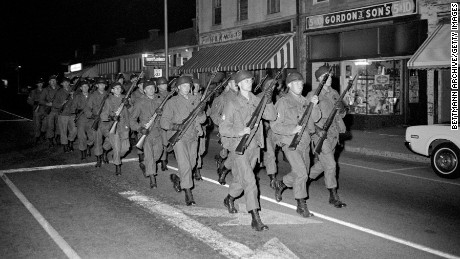 National Guardsmen with rifles and fixed bayonets march double-time on February 8, 1968, outside the main entrance to South Carolina State.