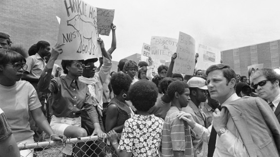 Sen. Birch Bayh, D-Indiana, passes demonstrators protesting the slayings of two African-Americans on the campus of Jackson State College in May 1970.