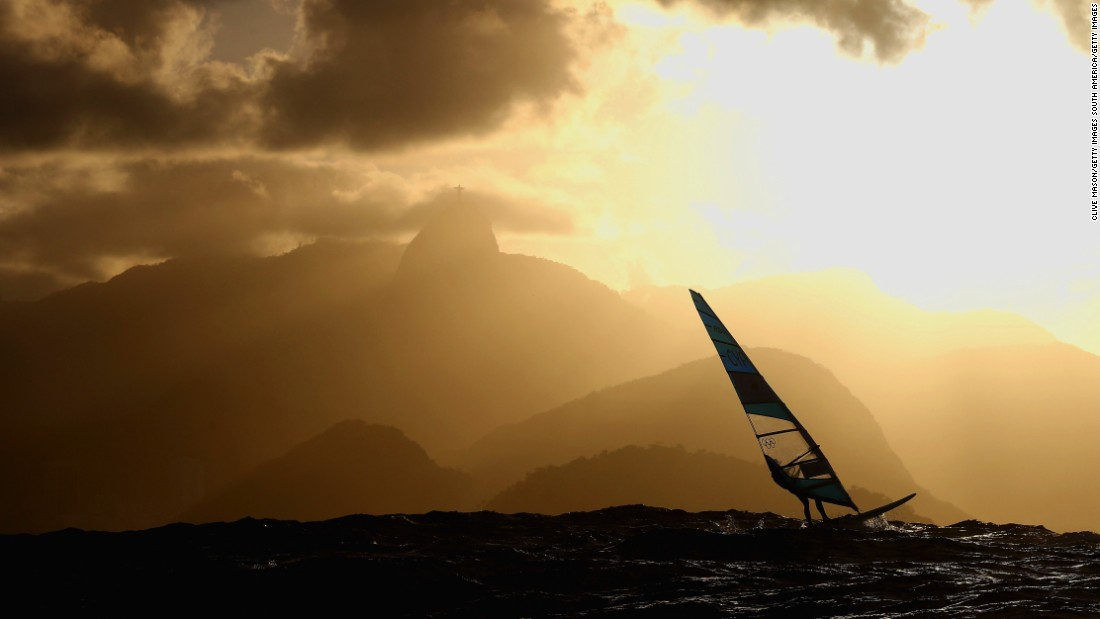 "The sun was beginning to set over the Marina da Glória and award-winning sports photographer Clive Mason was finishing up for the day. All he needed was that one perfect shot and, ""as if by magic,"" Cypriot windsurfer Andreas Cariolou glided directly past the press boat as he made his way to shore."